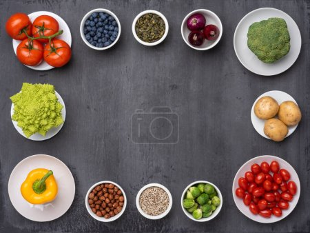 Photo for Healthy eating ingredients: fresh vegetables, fruits and superfood. Nutrition, diet, vegan food concept. Concrete background - Royalty Free Image