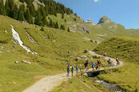 Photo for Engstlenalp, Switzerland - 9 August 2020: people trekking at Engstlenalp on the Swiss alps - Royalty Free Image