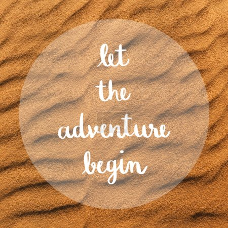 Photo for Let the adventure begin hand lettering on white sand dunes at Mui Ne, Vietnam. - Royalty Free Image