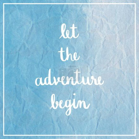Photo for Let the adventure begin Hand Lettering. Inspirational quote on blue crumpled paper. - Royalty Free Image