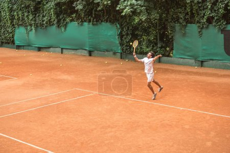 retro styled tennis player jumping with racket on tennis court