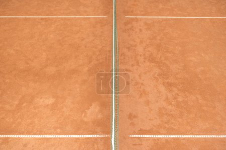 texture of brown tennis court with tennis net for game