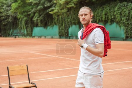 handsome old fashioned tennis player on court
