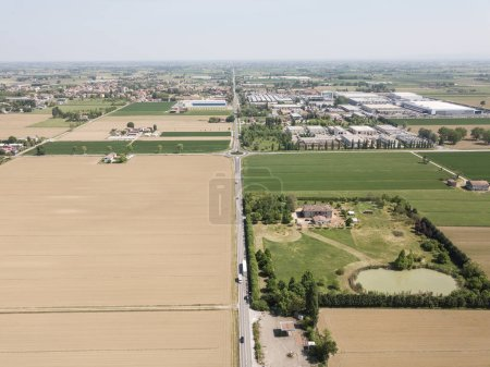 aerial view of road surrounded with agricultural fields, Italy