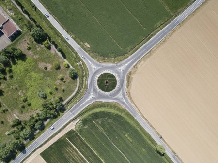 aerial view of four roads with roundabout surrounded with agro fields, Italy