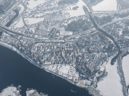 aerial view of snow covered city with river, Kyiv, Ukraine