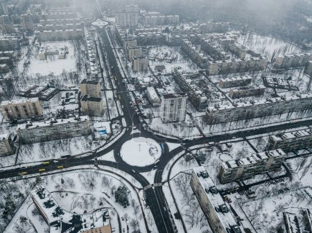 aerial view of apartment buildings on snowy streets with roundabout, Kyiv, Ukraine
