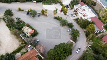 aerial view of houses with parking surrounded with various trees, Israel