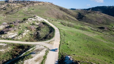 aerial view of car riding by mountain road, Israel