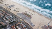 aerial view of town with lot of small houses and sandy seashore, Ashdod, Israel