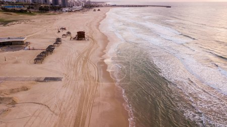 aerial view of empty sandy beach with tire tracks, Ashdod, Israel