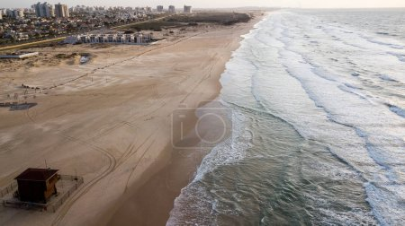 Photo for Aerial view of scenic empty sandy beach with wavy sea, Ashdod, Israel - Royalty Free Image