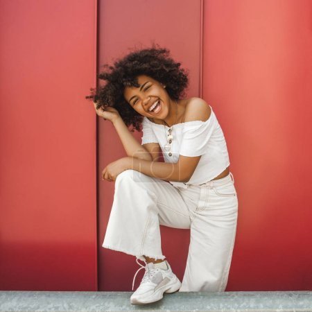 Photo for Beautiful happy stylish young african american woman smiling at camera - Royalty Free Image
