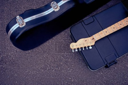 top view of musical instruments in cases lying on street