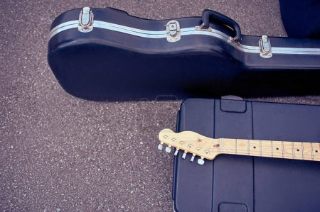 Photo for Close up view of musical instruments in cases lying on street - Royalty Free Image