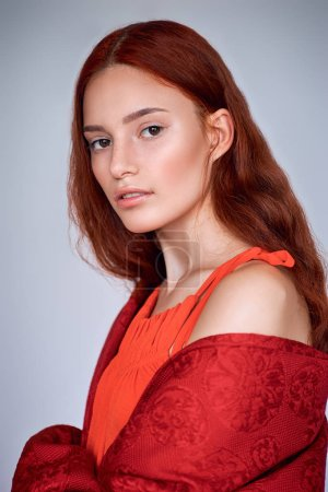 portrait of elegant fashionable girl with red hair, isolated on grey