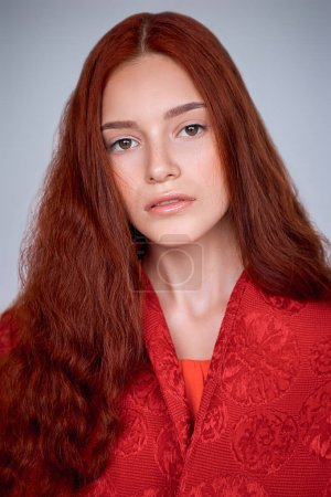 Photo for Portrait of attractive elegant girl with red hair, isolated on grey - Royalty Free Image