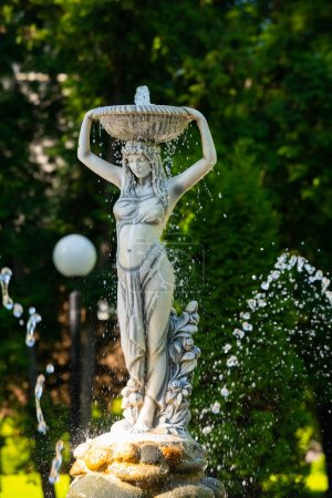 Photo for Fountain in the form of a girl with a basket on her head - Royalty Free Image