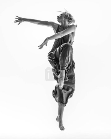 Photo for Young beautiful dancer is posing in studio - Royalty Free Image