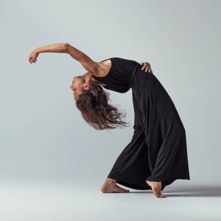 Photo for Beautiful female dancing contemporary dance style indoors - Royalty Free Image