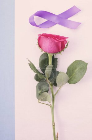 Photo for International Womens Day flat lay with pink rose, purple ribbon on pink and blue background with applied vintage wash filter. - Royalty Free Image