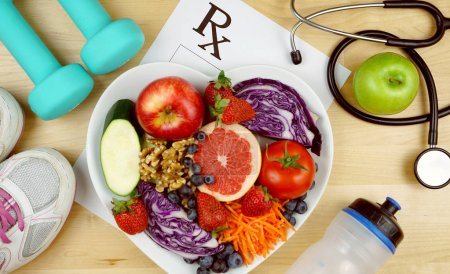 Photo for Prescription for good health overhead with stethoscope, healthy fresh food and exercise equipment. - Royalty Free Image