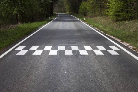 Photo for Concept start line pattern symbol painted on the countryside asphalt road floor. - Royalty Free Image