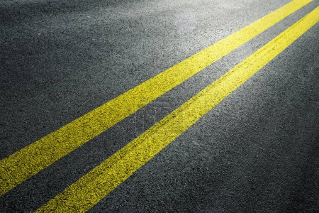 Photo for Yellow double lines on sunny asphalt floor. - Royalty Free Image