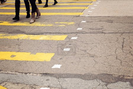 yellow crossroad with walking pedestrians, toning