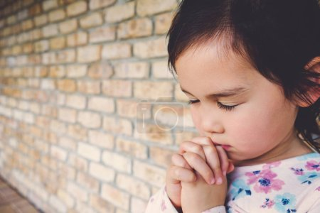 Photo for Little multiethnic girl praying, kid, child pray concept - Royalty Free Image