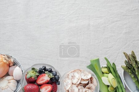 set of prebiotic foods for gut health in bowls on table