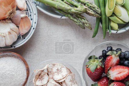 Photo for Set of prebiotic foods for gut health in bowls on table - Royalty Free Image