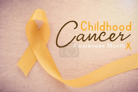 Photo pour Ruban or jaune, mois de sensibilisation mondiale childhood cancer - image libre de droit