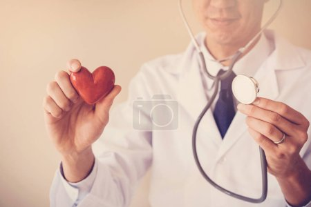Photo for Doctor holding red heart, heart health concept - Royalty Free Image