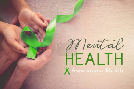 Adult and child hands holding Lime Green Ribbon, Mental health awareness month