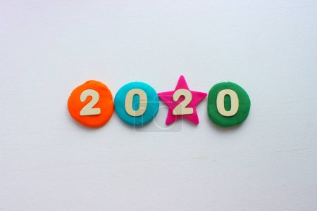 Photo for 2020 background .The concept of the new 2020. New year with colorful numbers 2020 on white background. Christmas card, congratulations. Copy space. - Royalty Free Image