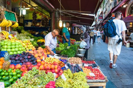 Photo for Istanbul, Turkey - August 28, 2013: Istanbul street fruit market with tourists and locals. Authentic Istanbul street life scene - Royalty Free Image
