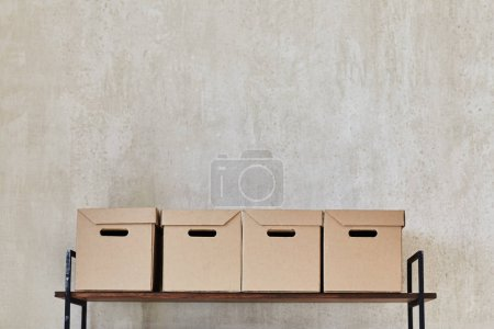 Shelf with boxes and books. Metal shelf