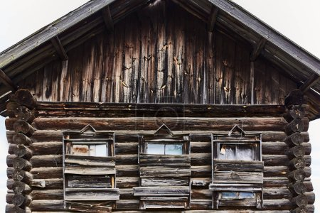 old wooden house with boarded-up