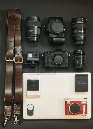 Photo for Set of photographer for travel. The layout of the cameras. My set of photo equipment. Notebook. - Royalty Free Image