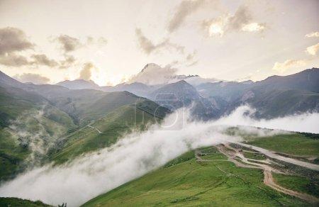 Mount Kazbegi in the setting sun. Caucasian mountains of Georgia.