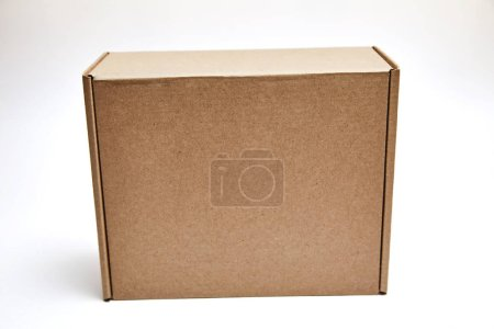 Photo for Cardboard Box isolated on a White background. brown parcel cardboard box for packages delivery - Royalty Free Image