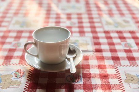 Photo for Cup of tea on the table. A Cup of freshly brewed black tea,escaping steam,warm soft light. - Royalty Free Image