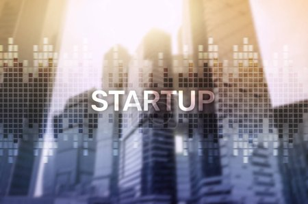 Startup concept with double exposure diagrams blurred background.
