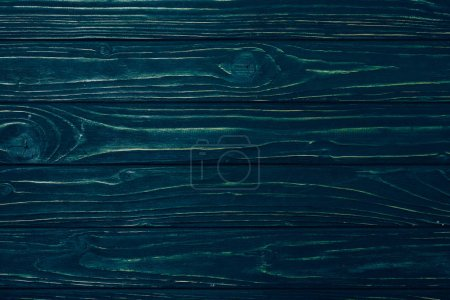 top view of dark blue wooden planks surface for background