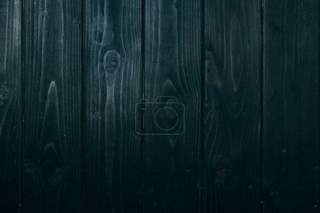 top view of vertical dark blue wooden planks surface for background