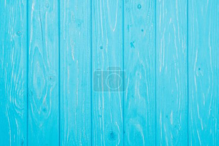 top view of vertical bright blue wooden planks surface for background