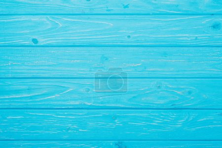 top view of bright blue wooden planks surface for background