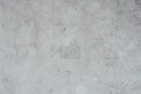top view of grungy white concrete wall for background