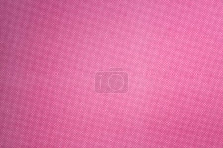 top view of pink surface with tiny white polka dot pattern for background